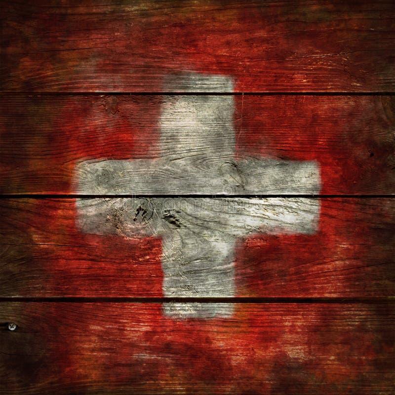 在木头的瑞士旗子 库存图片