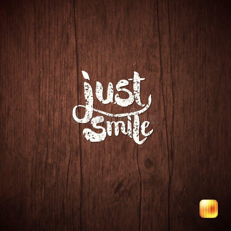 在木头的白色简单的文本概念微笑 免版税库存照片