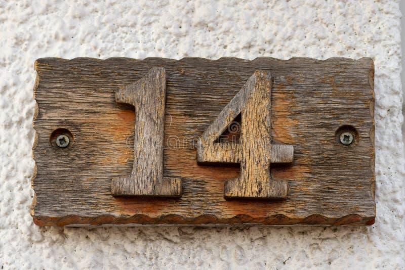 在木头14工作的房子号码 免版税库存图片