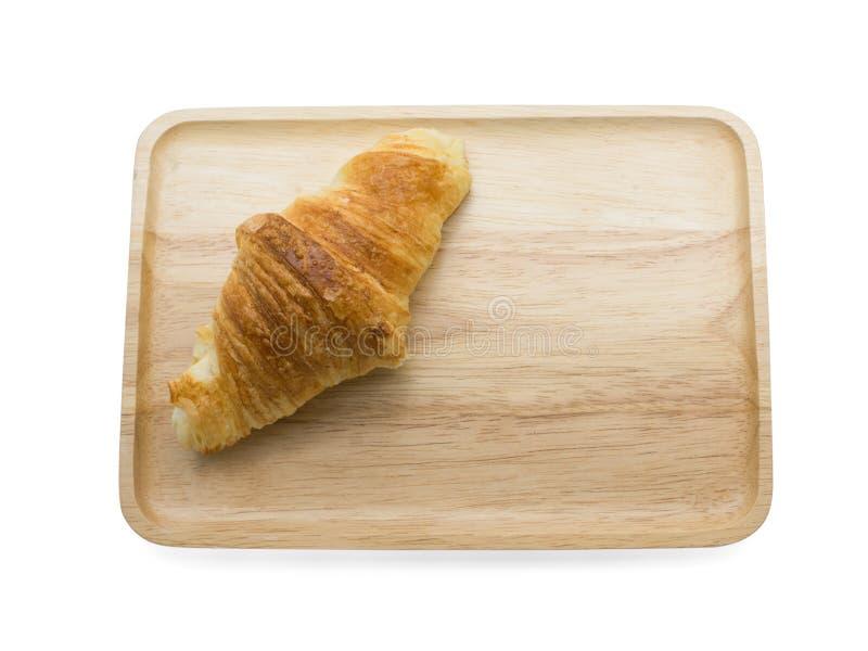 在木板材的新月形面包 库存照片