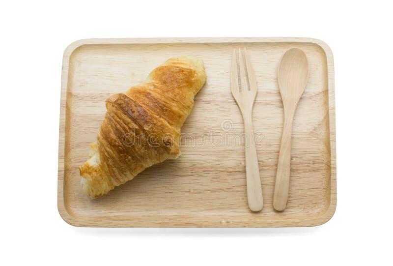 在木板材的新月形面包 库存图片