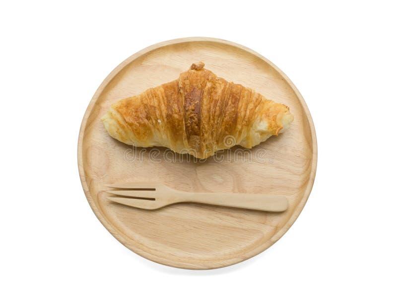 在木板材的新月形面包 免版税图库摄影