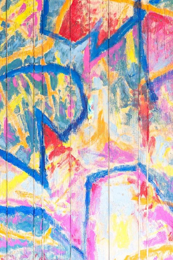 在木板条纹理背景的五颜六色的油漆 库存图片