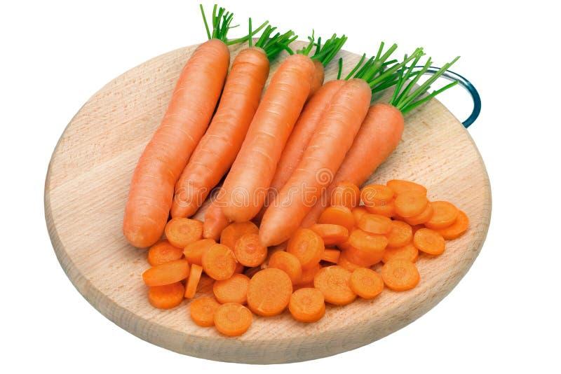 在木桌上的新鲜的未加工的红萝卜 免版税图库摄影