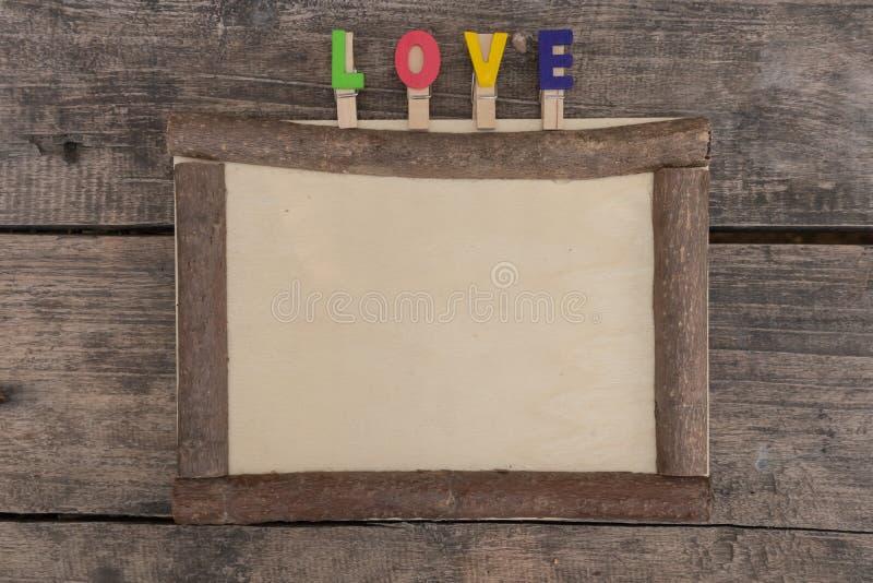 在木桌上的木制框架 免版税库存图片