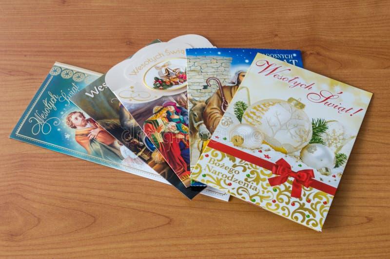 在木桌上的波兰圣诞节明信片 图库摄影