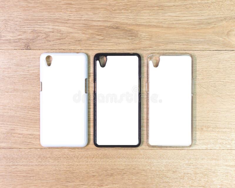 在木桌上的空白的电话盒在现代概念 蒙太奇或您的设计的空的流动盖子 库存照片