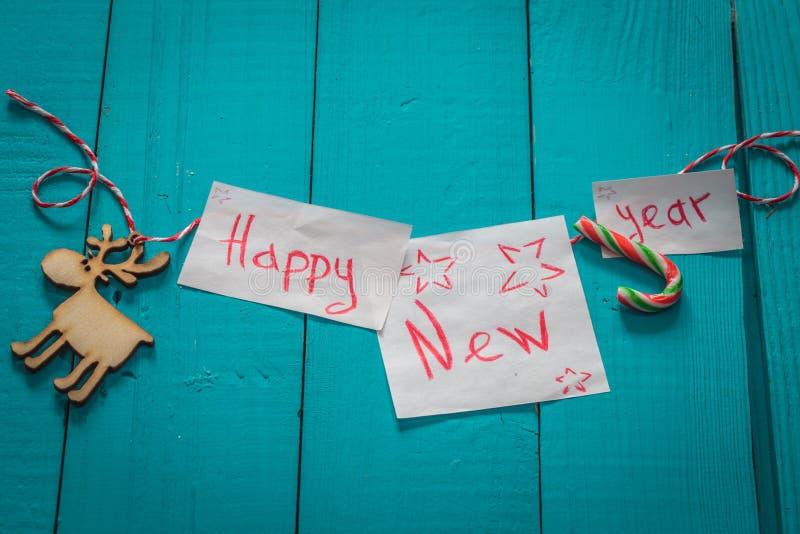 在木背景的新年好题字 免版税图库摄影