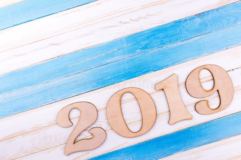 在木背景的木第2019年 免版税图库摄影