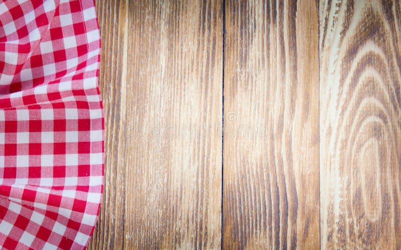 在木背景的桌布 快餐概念 免版税库存照片