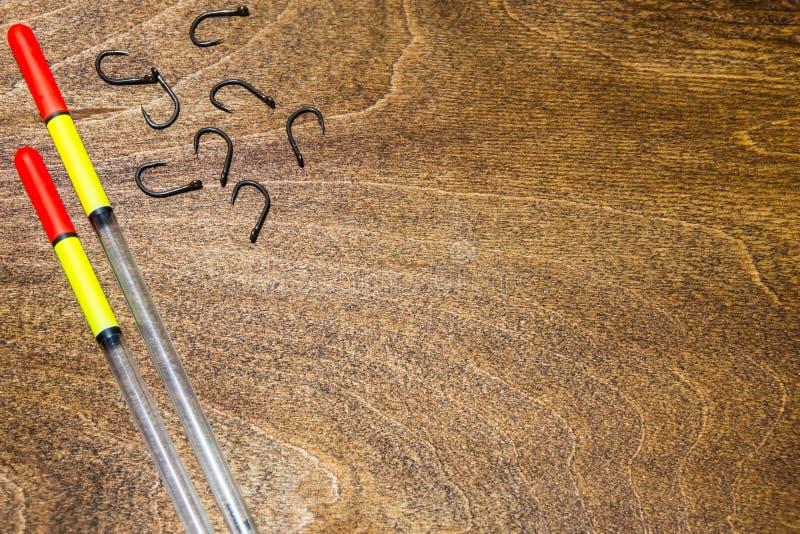在木背景的渔辅助部件 您的文本的地方 免版税库存图片
