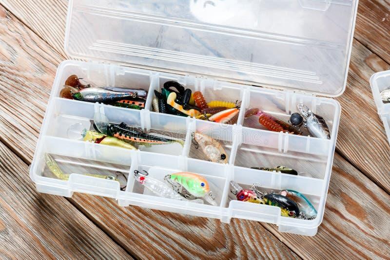 在木背景的渔辅助部件 免版税图库摄影