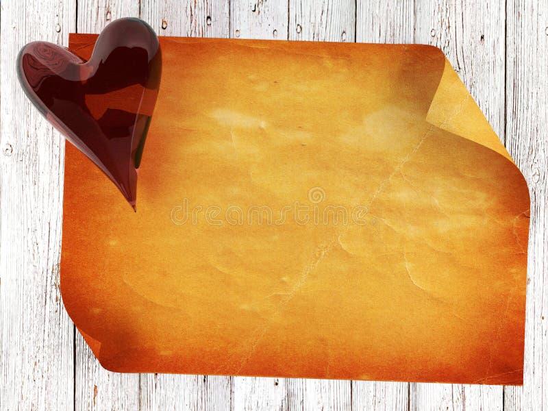 在木背景的老纸与红色玻璃心脏 库存图片