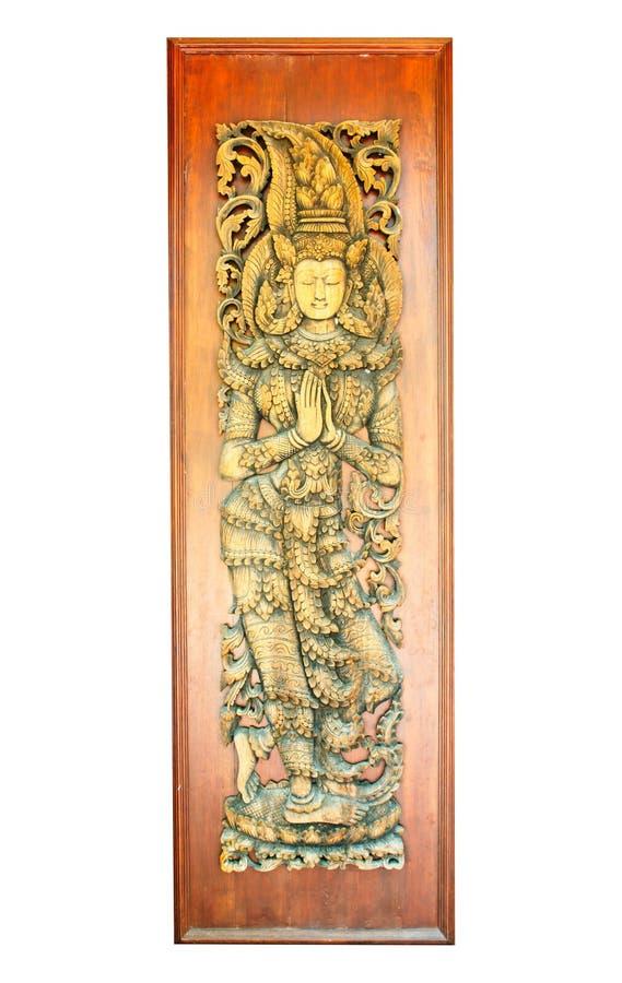 在木门的古老艺术样式在泰国寺庙 免版税图库摄影