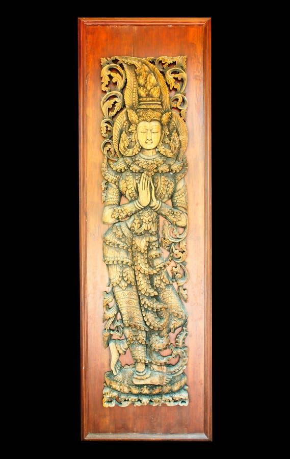 在木门的古老艺术样式在泰国寺庙 免版税库存照片