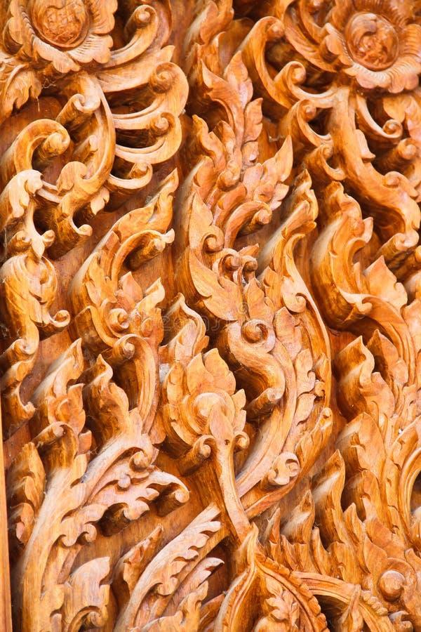 在木门的古老艺术模式 免版税库存照片