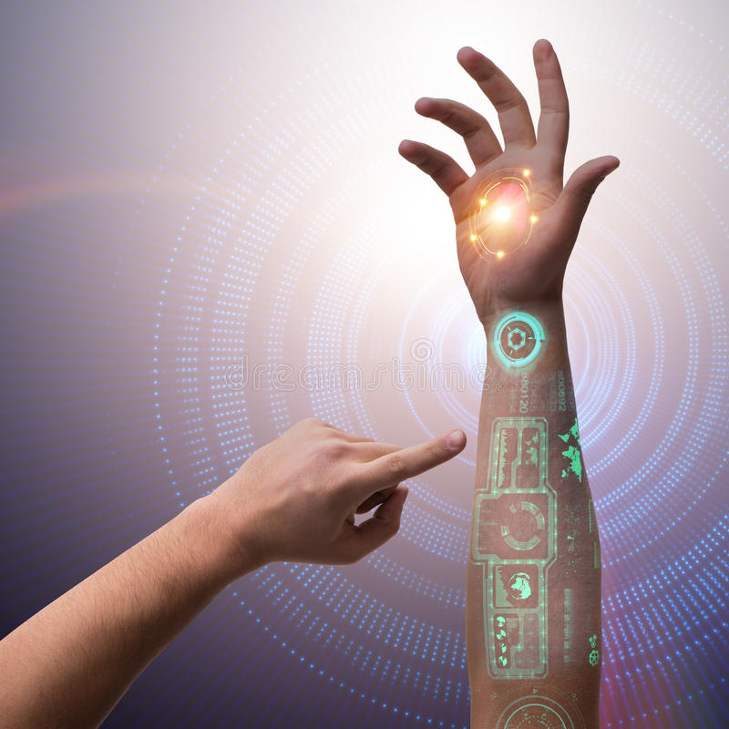 在未来派概念的人的机器人手 免版税库存照片