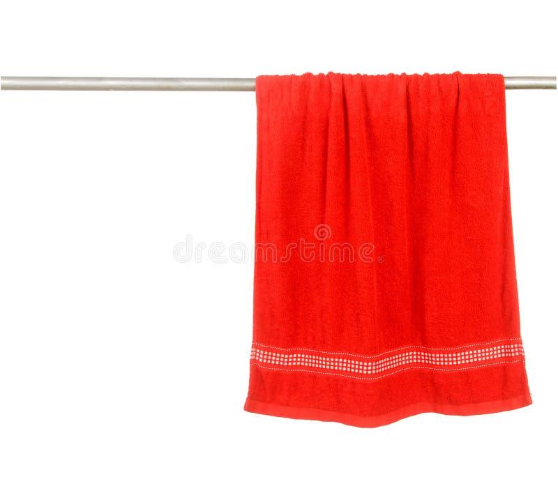 在机架的红色毛巾吊 图库摄影