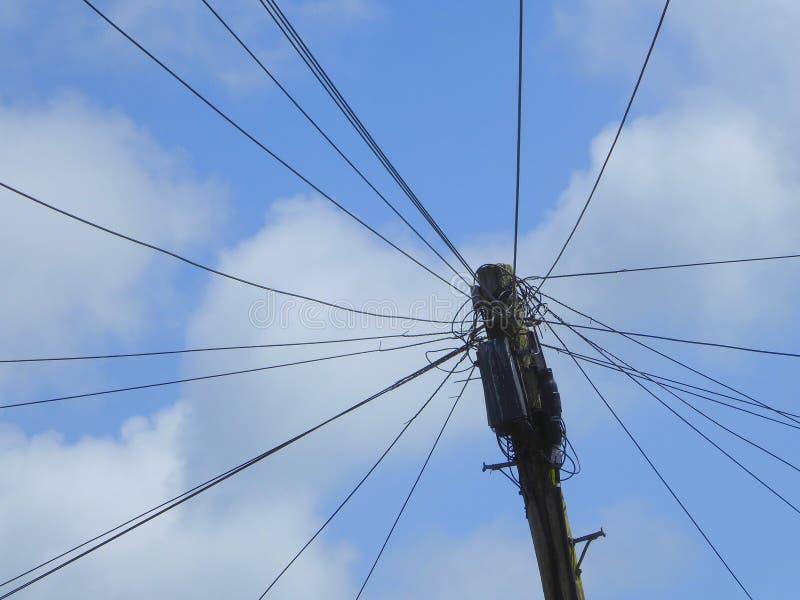 在杆顶部的电话电汇 免版税库存图片