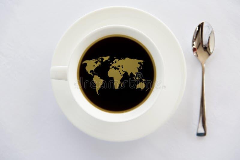 在杯子的世界地图与匙子的无奶咖啡 库存照片