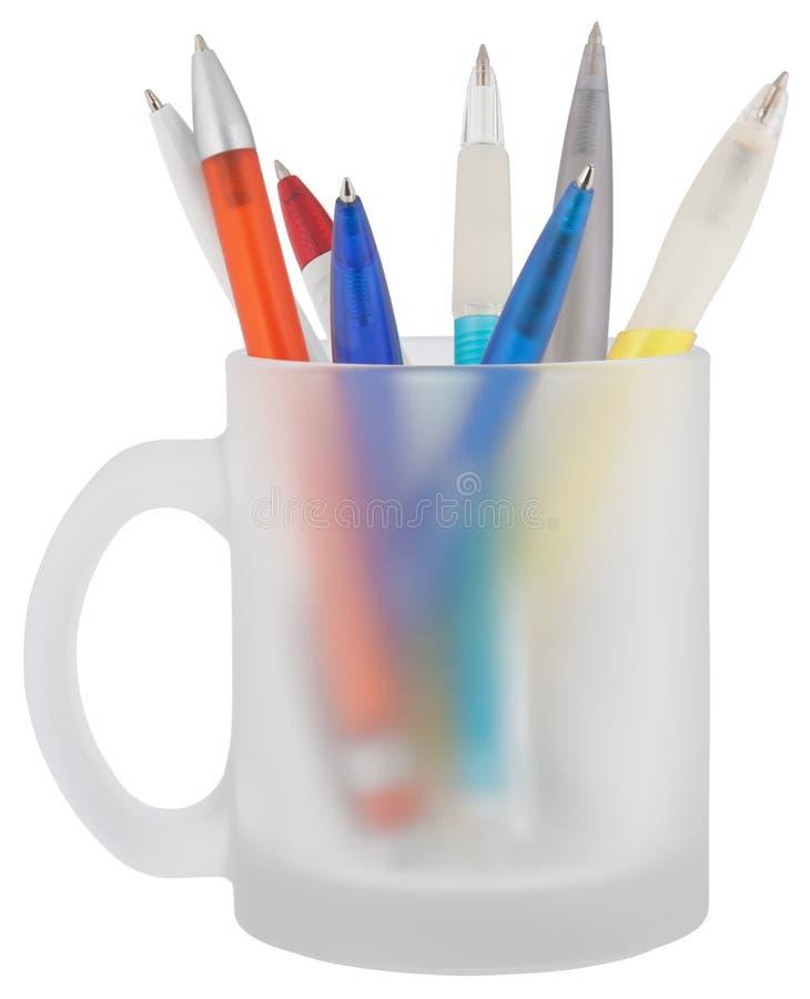 在杯子的笔 免版税库存照片