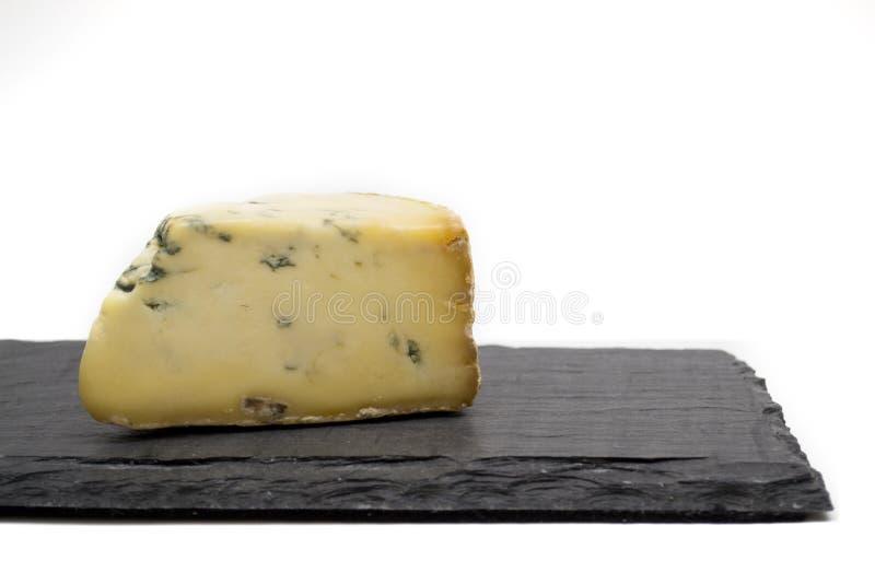在板岩板的乳酪 库存图片