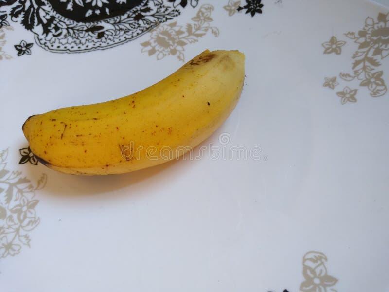 在板材的一个香蕉 免版税库存图片