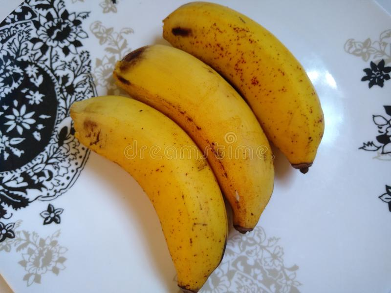 在板材的三个香蕉 免版税库存图片