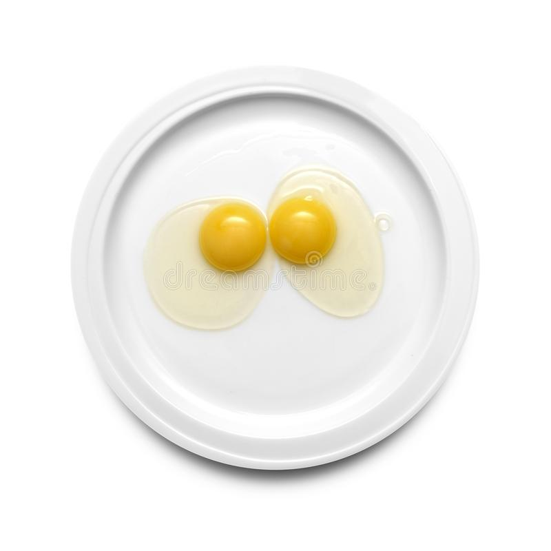 在板材的两个鸡蛋黄 库存图片