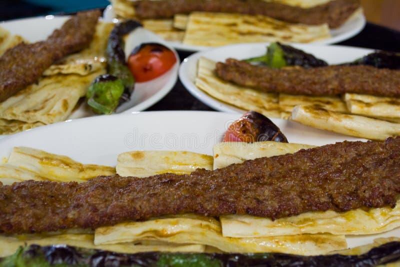 在板材的土耳其食物阿达纳kebab 库存图片