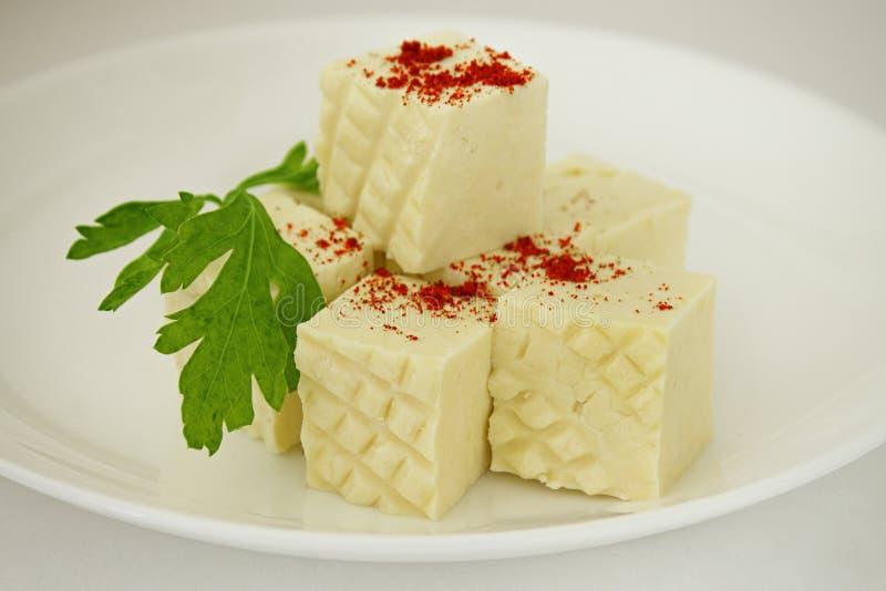 在板材的希腊白软干酪 免版税库存图片
