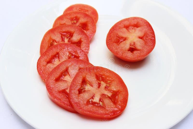 在板材的蕃茄切片 库存图片