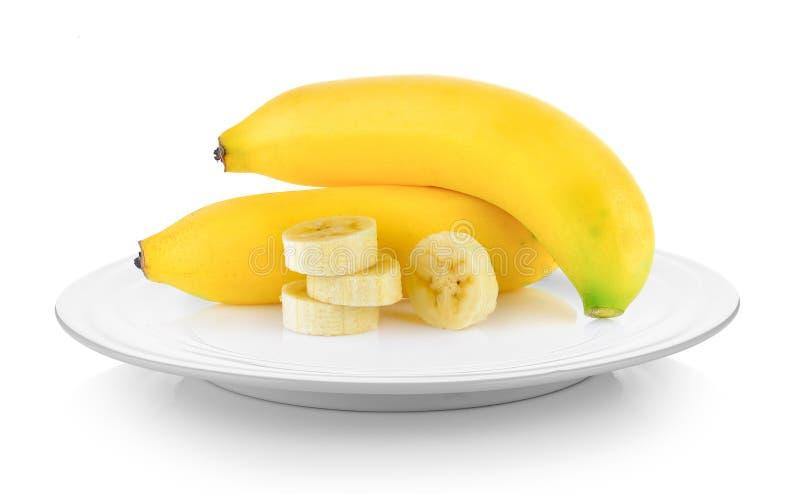 在板材的香蕉在白色背景 免版税库存图片