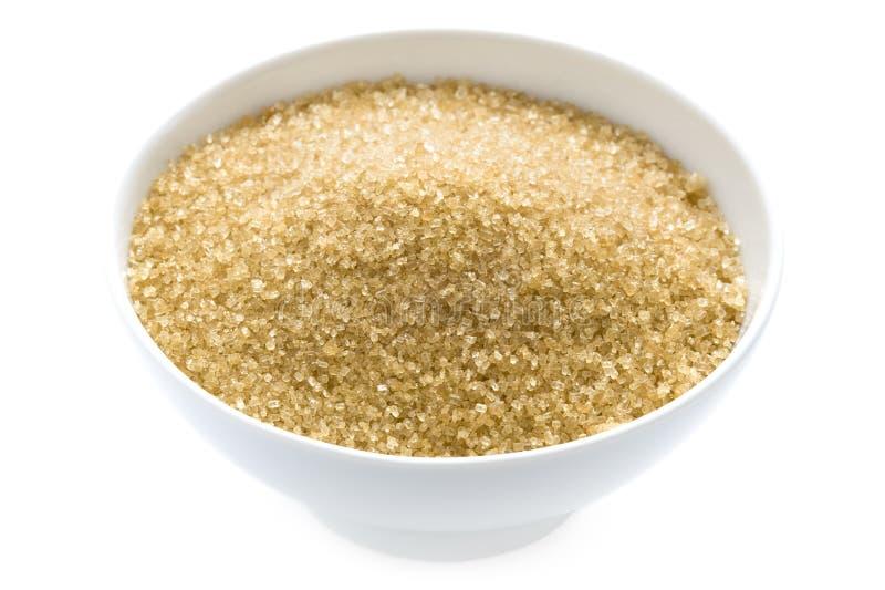 在查出的碗的Demerara糖 免版税库存图片