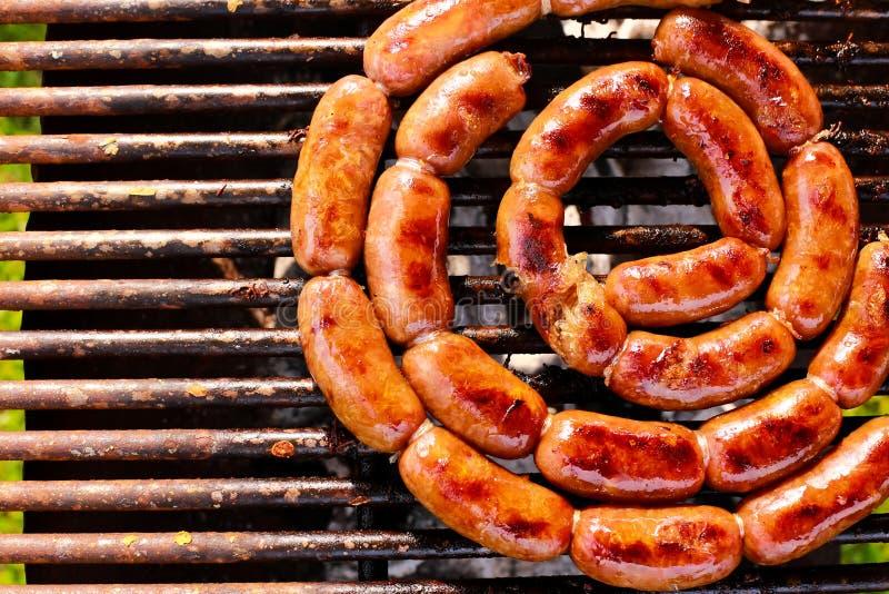 在格栅的烤猪肉香肠 库存照片