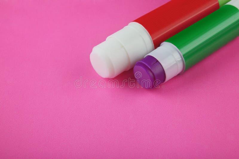 在桃红色的胶浆棍子 免版税库存图片