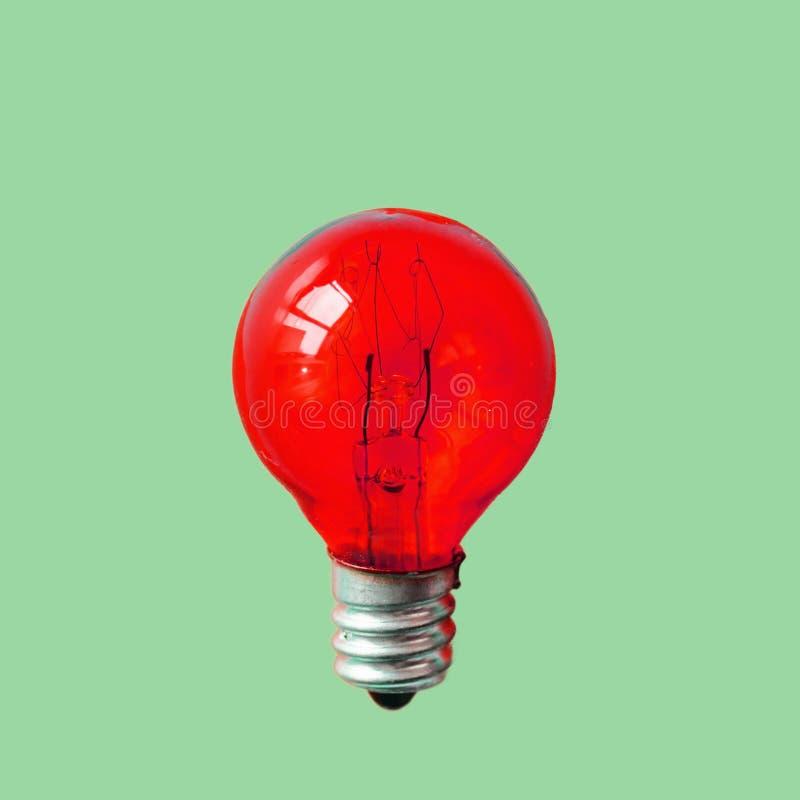 在桃红色背景的红色灯 库存照片