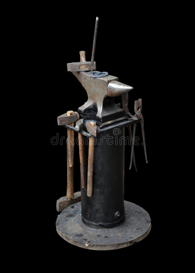 在框架的被隔绝的铁匠铁砧和一套铁匠t 图库摄影