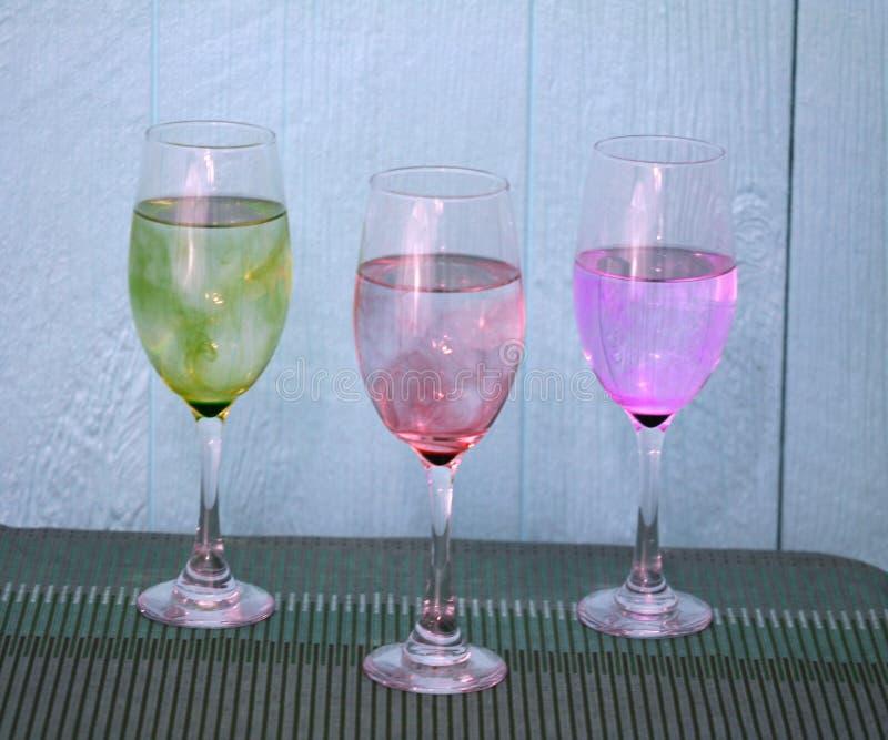 在桌上的三酒glsses 免版税图库摄影
