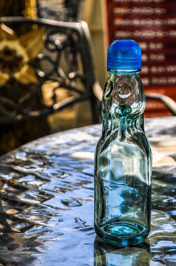 在桌上的空的科德脖子瓶 免版税图库摄影
