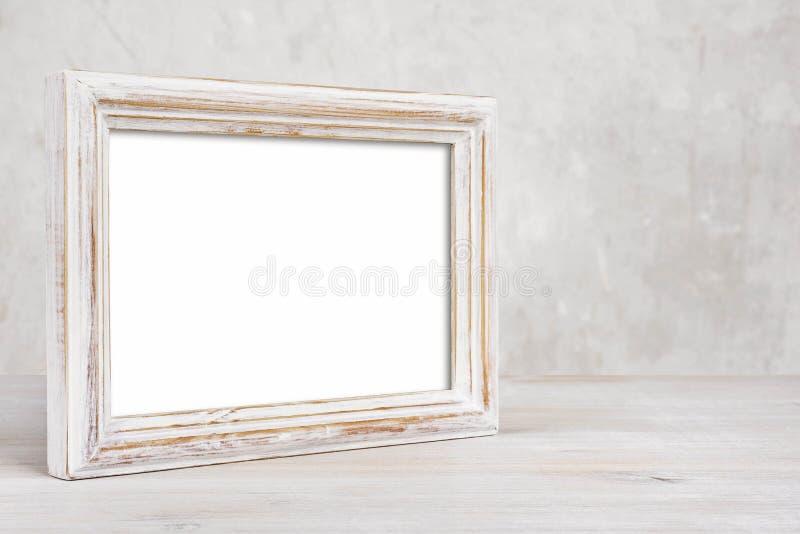 在桌上的老被绘的照片框架在抽象背景 免版税库存照片