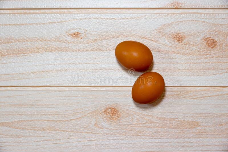 在桌烹调的两个鸡蛋 免版税图库摄影
