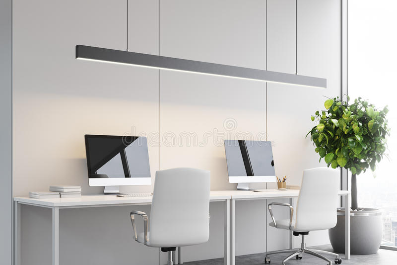 在桌,办公室,边上的两台计算机 皇族释放例证