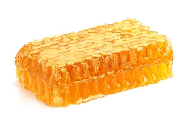 在梳子的新鲜的蜂蜜。 库存照片