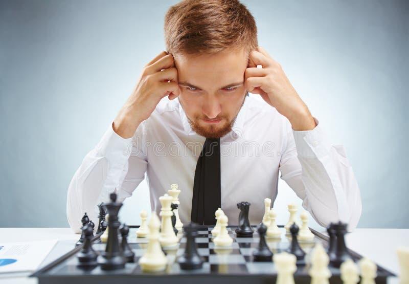 在棋枰的商人 免版税库存照片