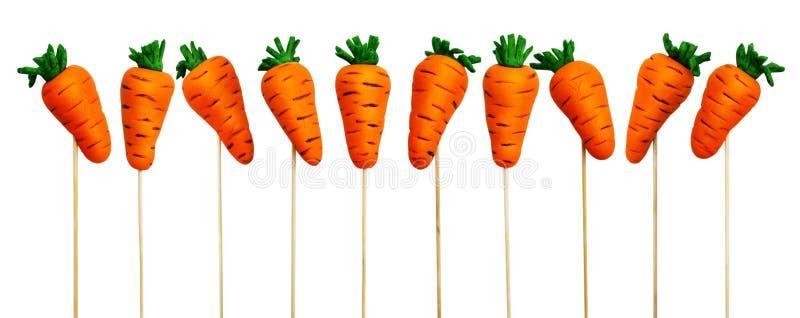 在棍子的复活节红萝卜 库存照片