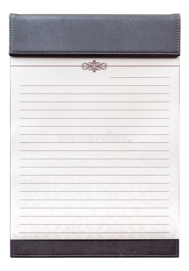在棕色剪贴板的空白的笔记薄在会议室 免版税图库摄影
