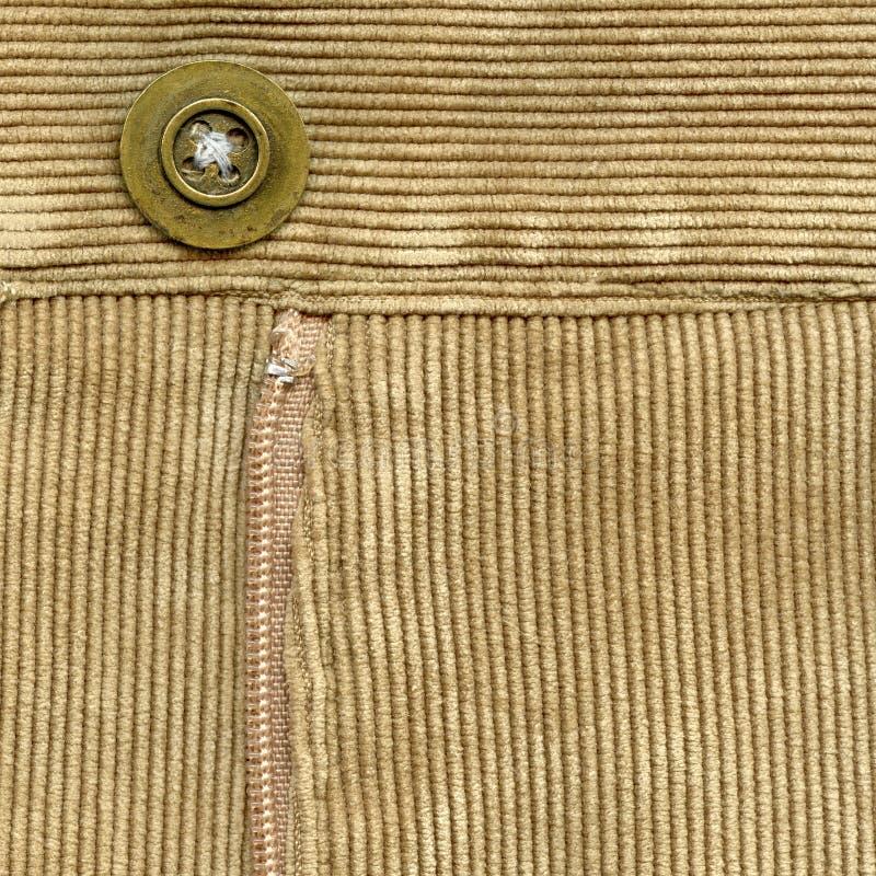 在棕色条绒的拉链 免版税库存图片