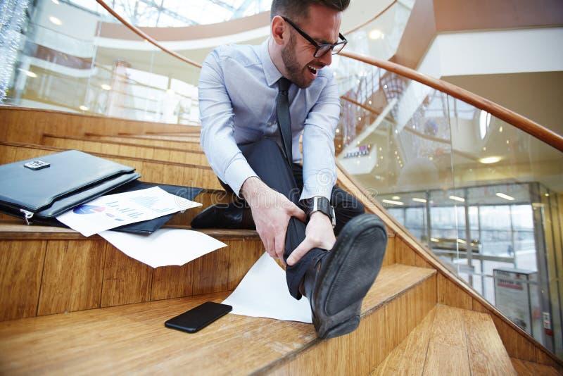 在楼梯的事故 免版税图库摄影