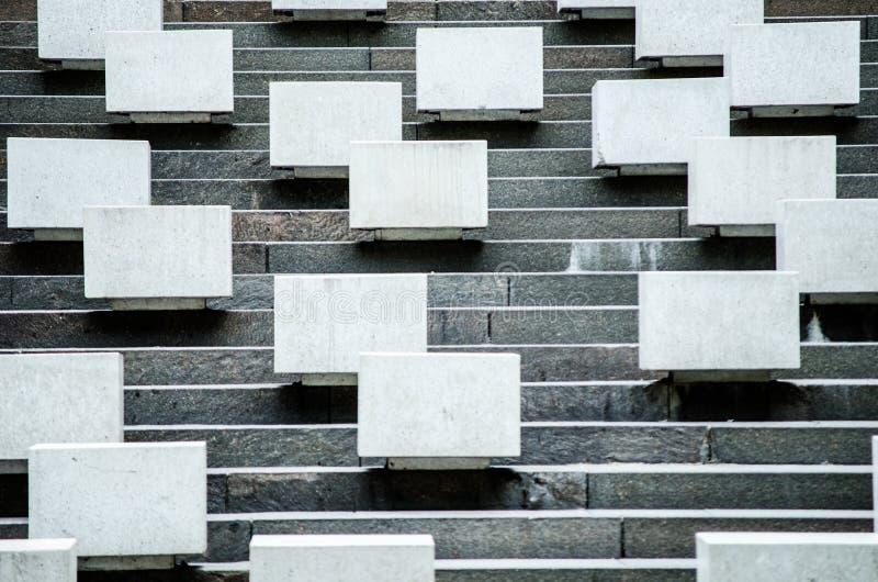 在楼梯的具体方形的位子 免版税库存图片
